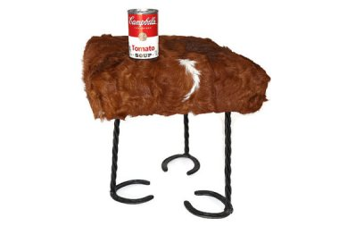 Not sure why there is soup on this awful cowhide stool, but shouldn't it at least be beef & barley?