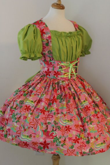 Though it is described as a hula dress, I think they're getting their dances confused...