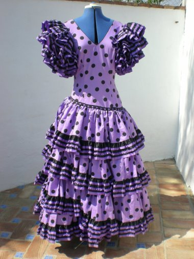 I get the flamenco silhouette, but the purple polka dots are just tragic.