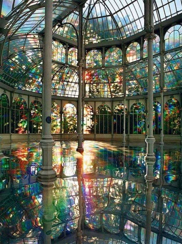 Kimsooja installation at the Palacio de Cristal, Parque del Retiro, in Madrid. The windows of this 1800s greenhouse were covered with a special translucent film to create naturally-occurring rainbows